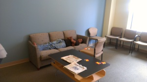 Picture of an exhausted team member sleeping after working on all night during the Hackathon