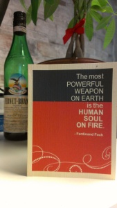 """Picture of a card with the quote """"The most powerful weaopon on earth is the human soul on fire"""""""