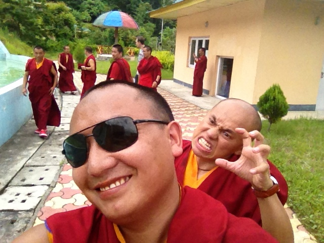 A Buddhist monks photobombs a selfie in southeast Asia